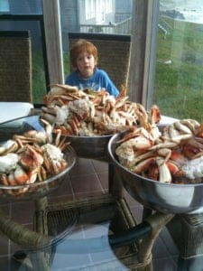 Elliot with a lot of Dungeness crab.