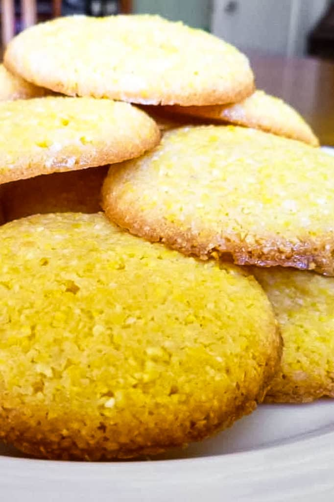 A low-angle shot of lemon polenta biscuits piled on a plate.