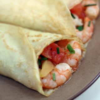 Crepes filled with shrimp, tomato, and chives