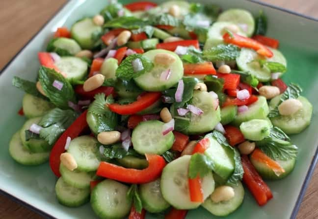 Cucumber salad with peanuts, red peppers, lime juice, and mint