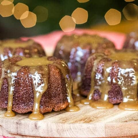sticky toffee pudding cakes on a board drizzled with toffee sauce
