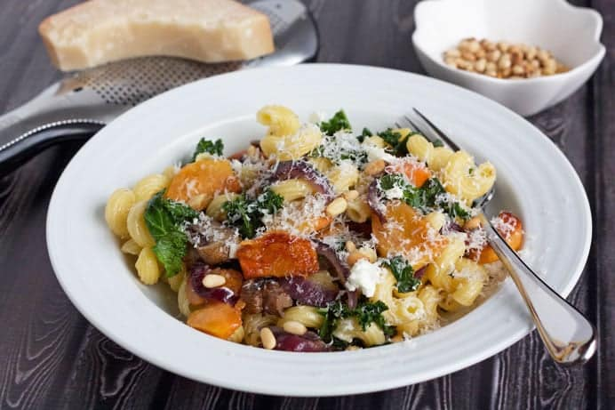 fuyu persimmon pasta with goat cheese in a serving bowl