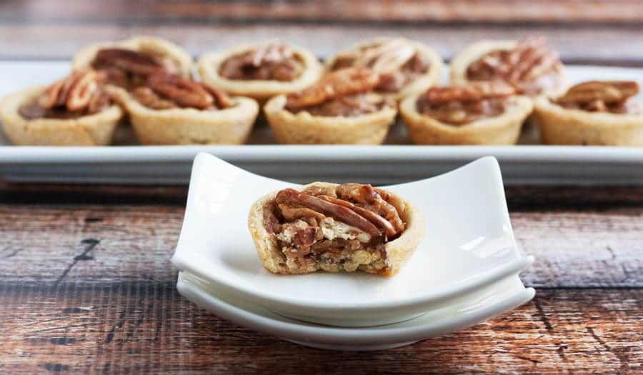 gluten free pecan tartlets one with a bite out of it