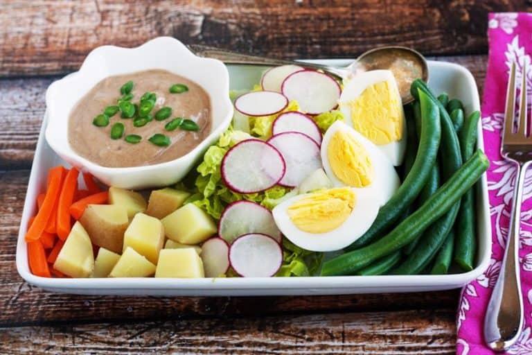 thai peanut sauce on a gado gado salad