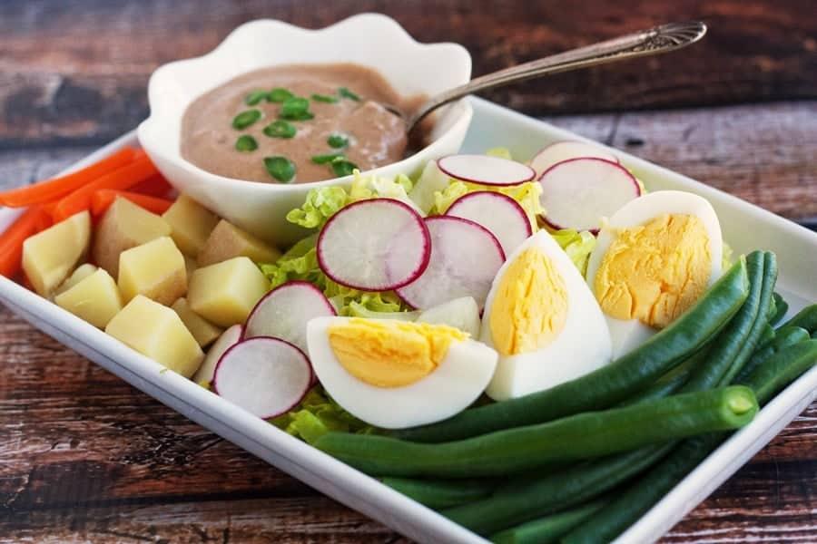 thai peanut sauce on platter with gado gado salad