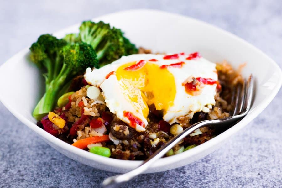 ling ling fried rice with a fried egg on top and extra gochujang