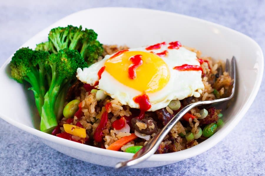 ling ling bibimbap fried rice with an egg on top and extra gochujang