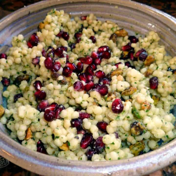 Israeli Couscous Salad with Pomegranate Seed, Pistachios, and Hummus Vinaigrette