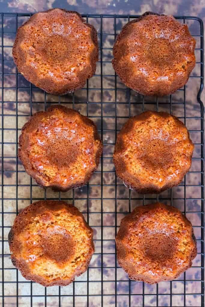 Mini rosh hashanah cakes cooling on a rack shot from above