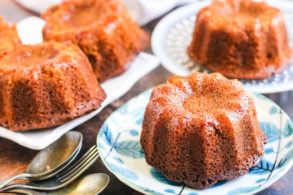 Rosh hashanah honey cake baked in a mini bundt pan on little plates