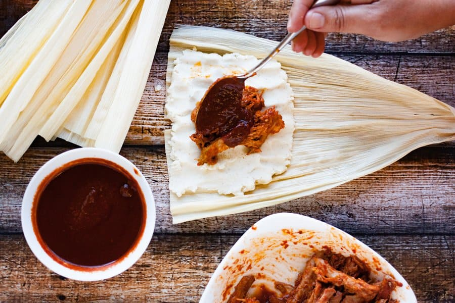 filling and saucing homemade tamales