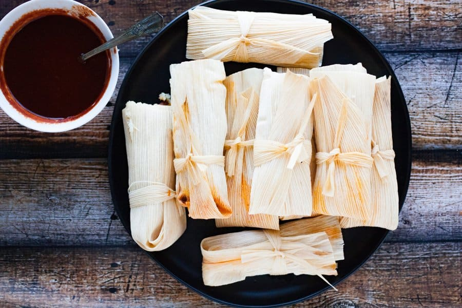 easy to make tamales piled on a black plate