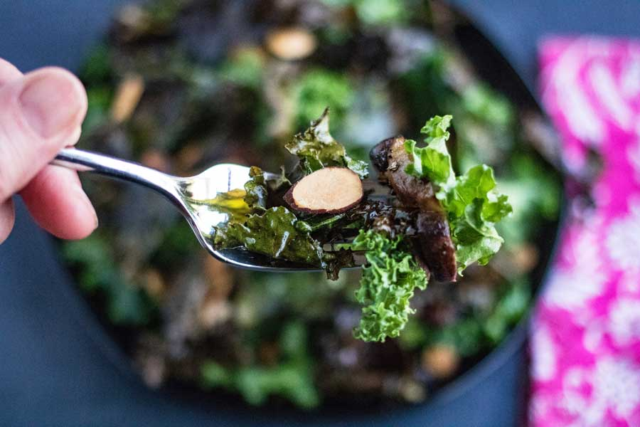 forkful of kale salad with miso dressing