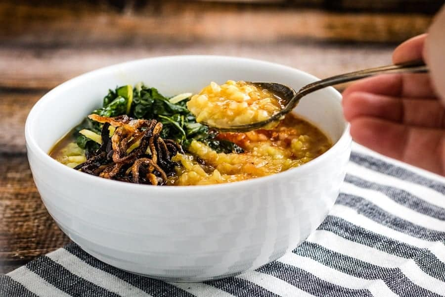 instant pot congee in a bowl with a spoon