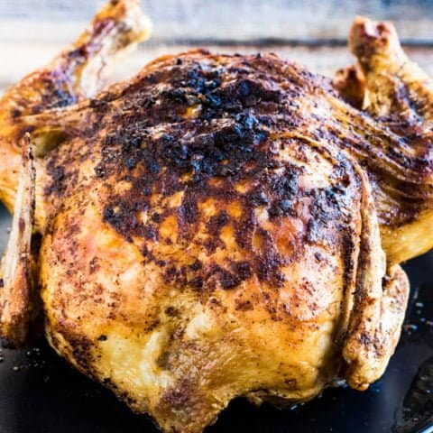 A whole chicken cooked in an air fryer--crispy-skinned, succulent, and flavorful