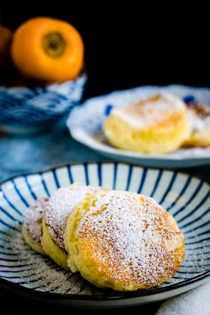 fluffy japanese pancakes on a striped japanese plate