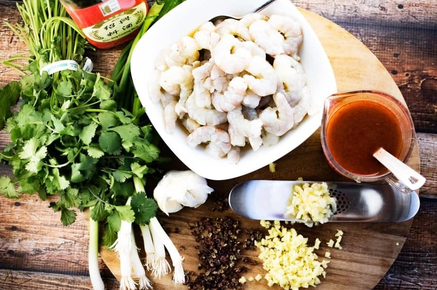 Ingredients for szechuan shrimp include shrimp, cilantro, garlic, ginger, szechuan peppercorns, and shaoxing wine.