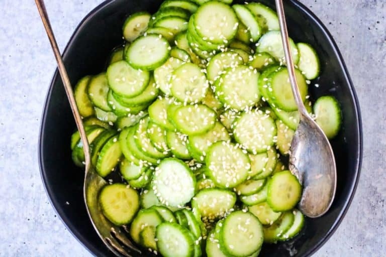 Japanese cucumber salad ready to serve in a black salad bowl