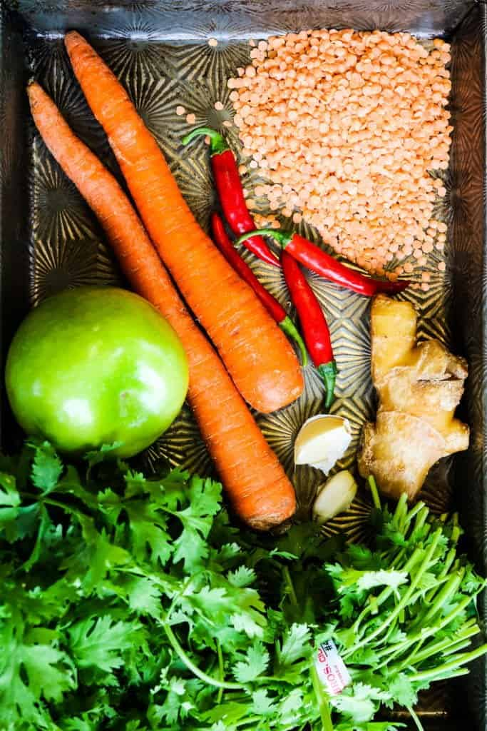 ingredients for instant pot mulligatawny soup--rice, lentils, apples, carrots, chiles, cilantro, ginger, and more