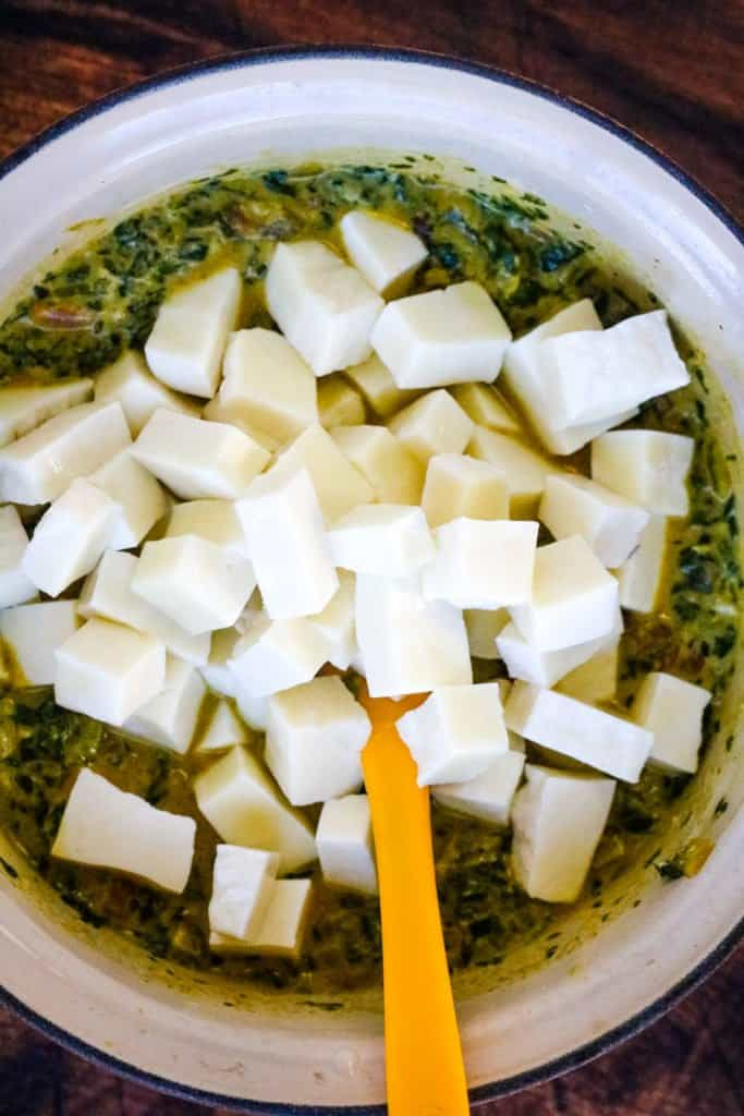 adding the cubed paneer to the pot