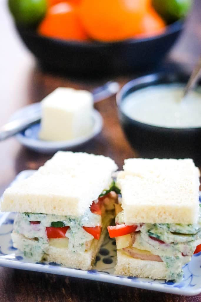 Bombay Sandwiches layered with potato, tomato, cucumbers, and an herb chutney sauce