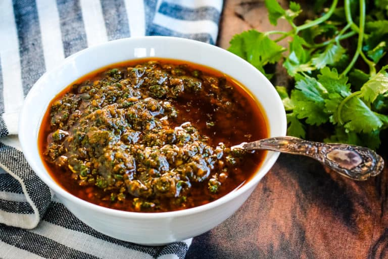charmoula in a white bowl with a spoon