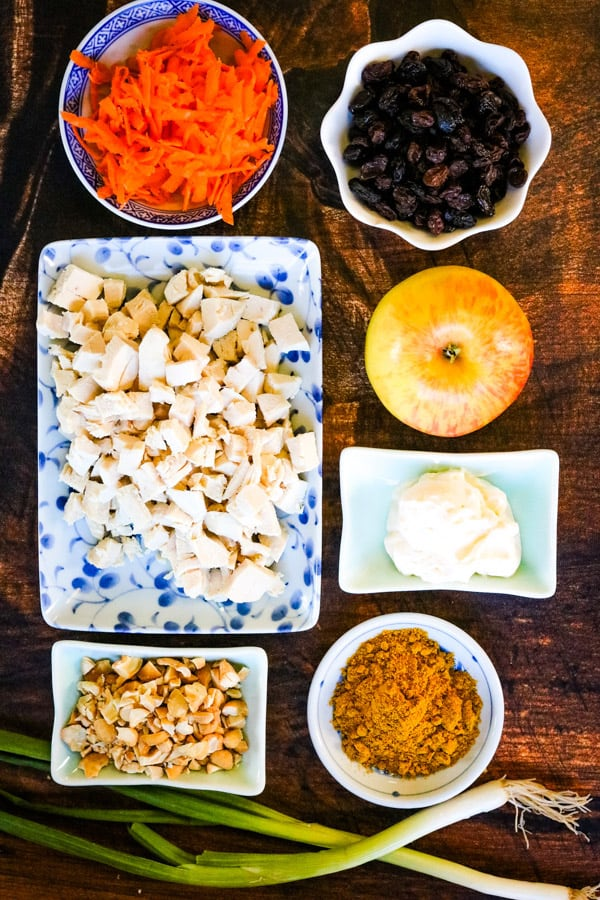 Ingredients for curried chicken salad with apples, raisins, and cashews