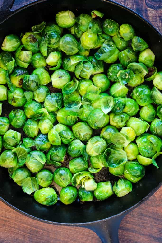 sprouts cooking in a cast-iron skillet