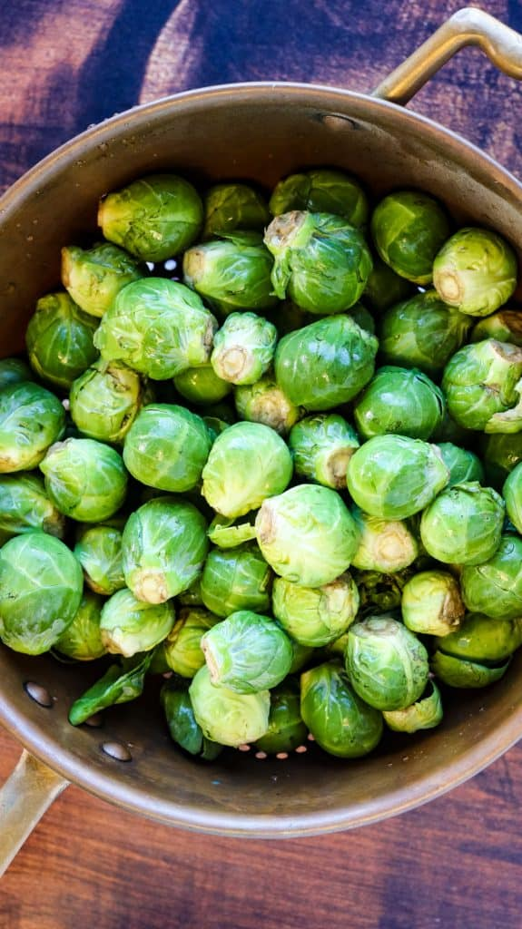 whole brussels sprouts in a colander