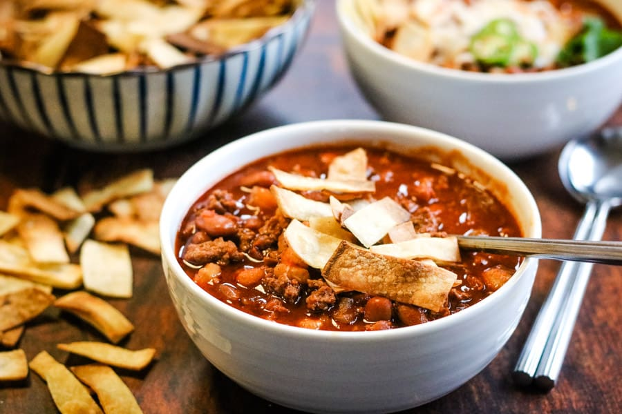 Instant pot chili in a bowl with oven-baked tortilla strips