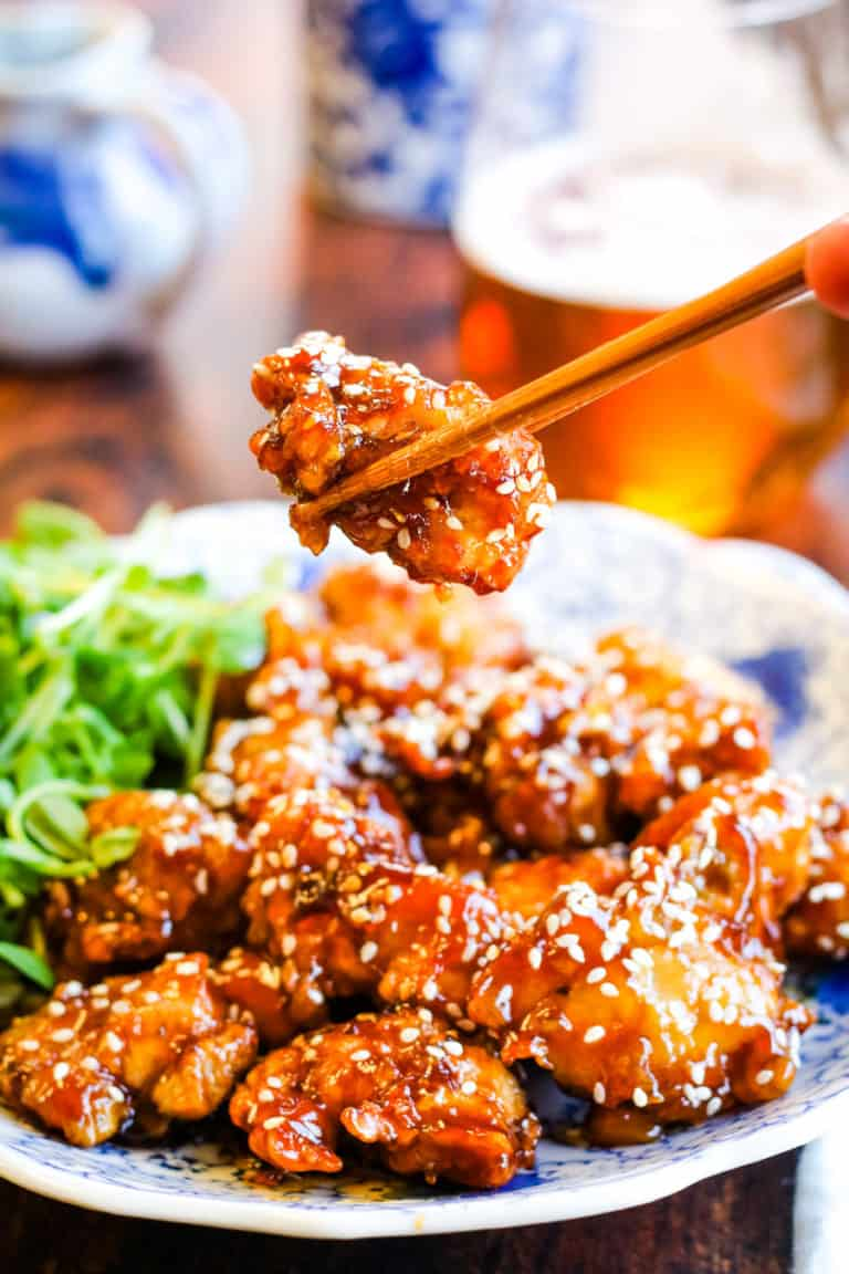 sesame chicken with chopsticks