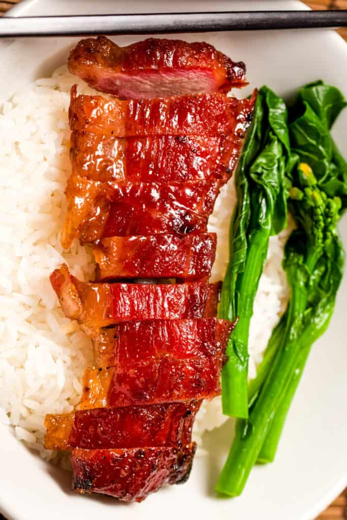 Overhead shot of char siu pork sliced over rice with Chinese broccoli