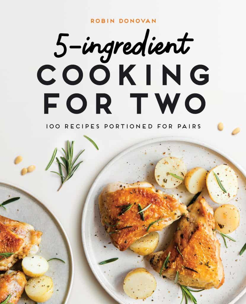 Image is of the book cover for 5 Ingredient Cooking for 2 by Robin Donovan. The title is at the top in text and there is an image of chicken and potatoes on a plate with fresh rosemary and black pepper.