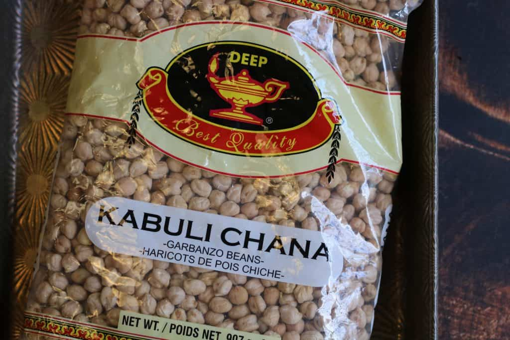 overhead shot of a bag of dried chickpeas. The brand is Deep and they are called kabuli chana