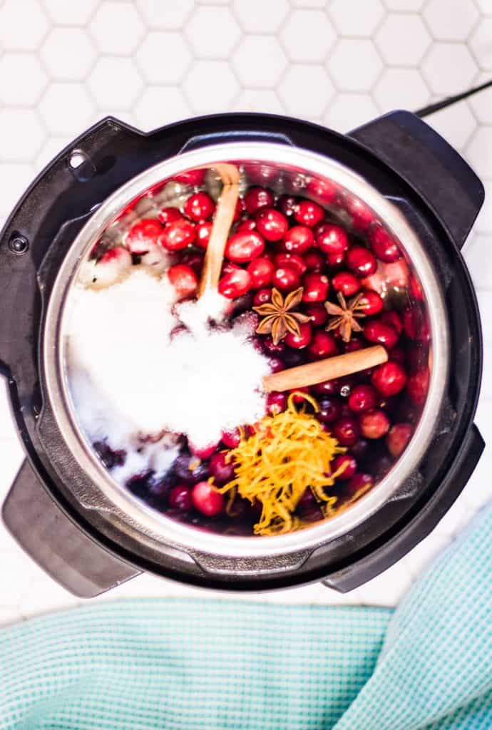 Ingredients in the instant pot to make cranberry sauce, shot from overhead.