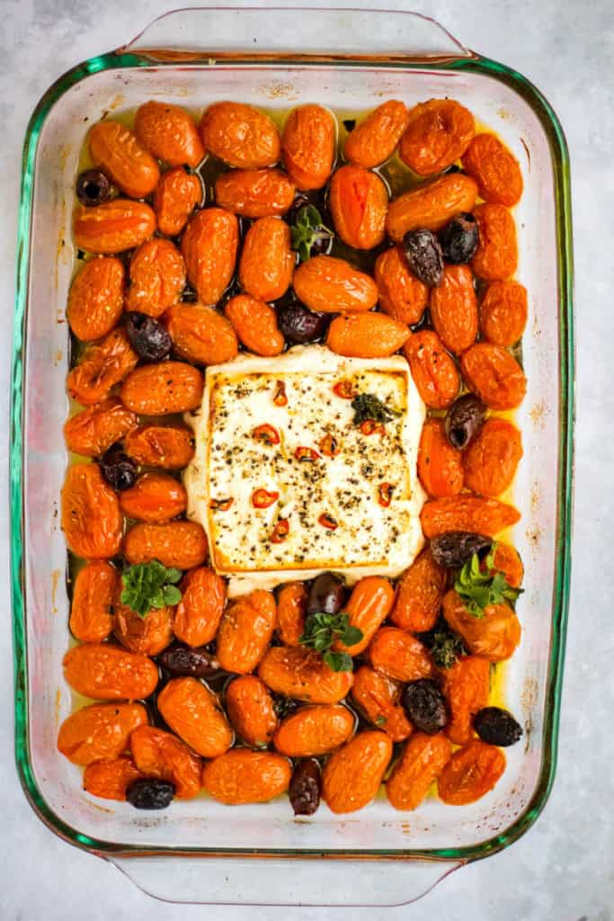 overhead shot of the baked tomatoes and feta for this pasta recipe in a baking dish
