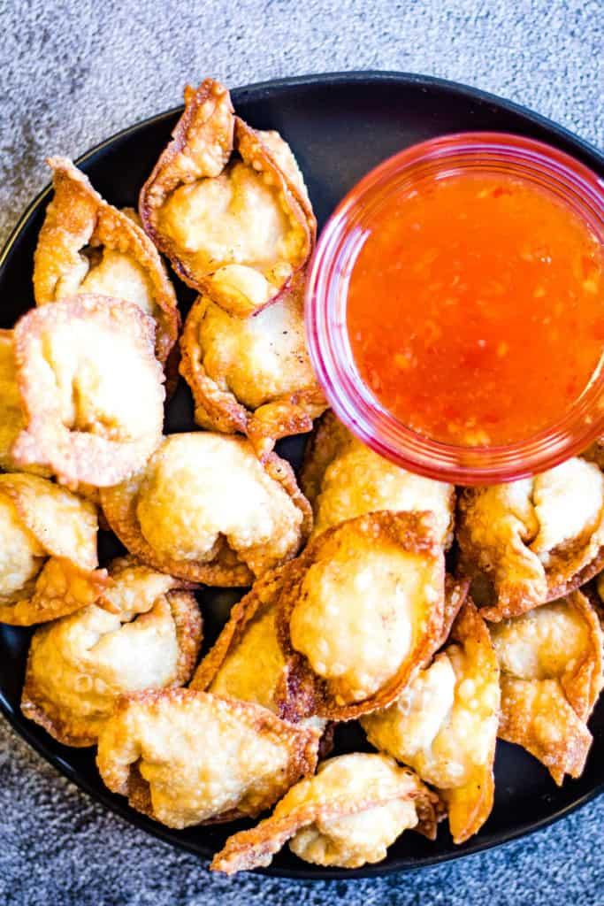 Overhead shot of a plate of crispy fried pork and shrimp wontons