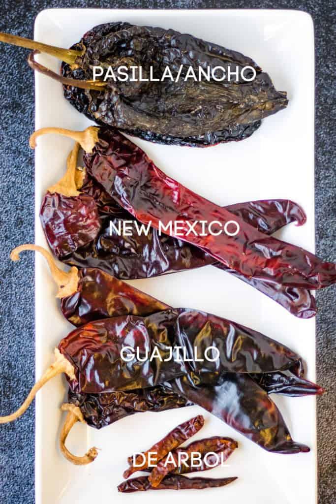 overhead shot of 4 different types of chiles: pasilla/ancho, new mexico, guajillo, and de arbol. These are the chiles used in this camarones a la diabla recipe.