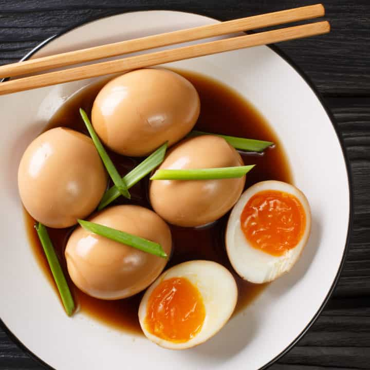 Overhead shot of soy sauce eggs on a plate.