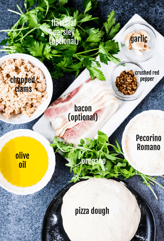 Overhead shot of the ingredients needed to make white clam pizza.
