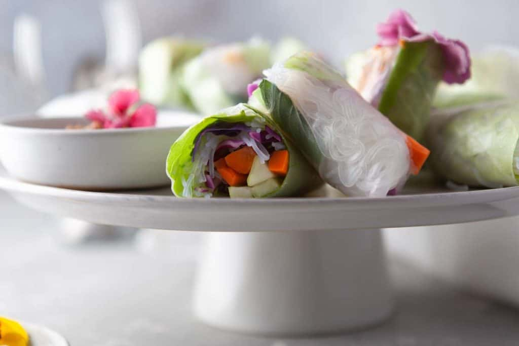Low angle shot of summer rolls on a platter.