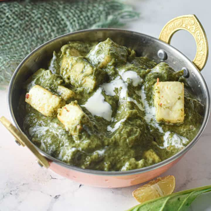 low angle shot of a bowl of instant pot palak paneer