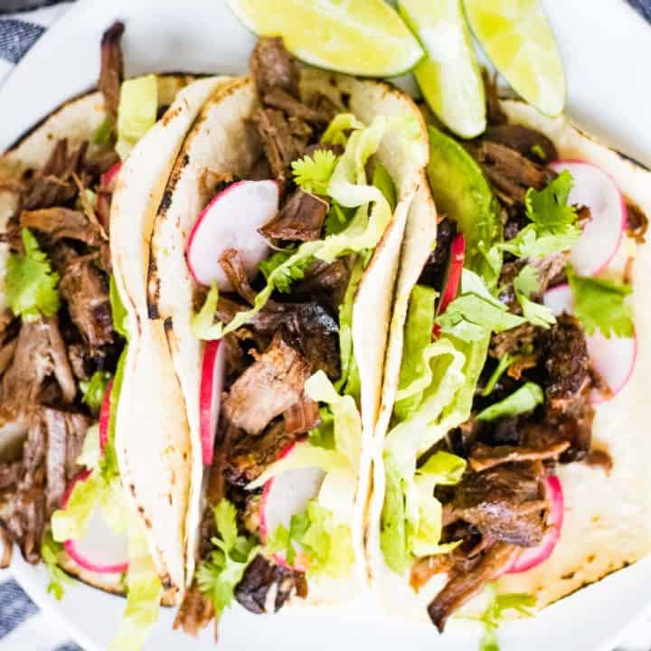 overhead shot of 3 Mexican shredded beef tacos