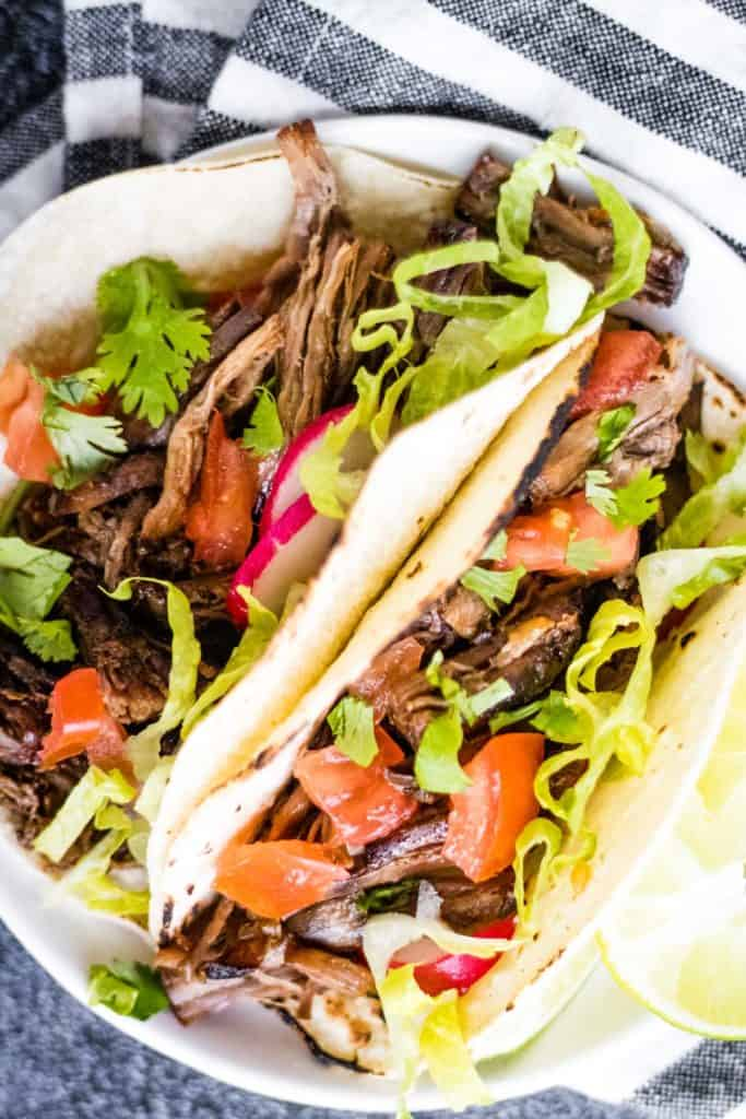 overhead shot of two tacos filled with Mexican shredded beef