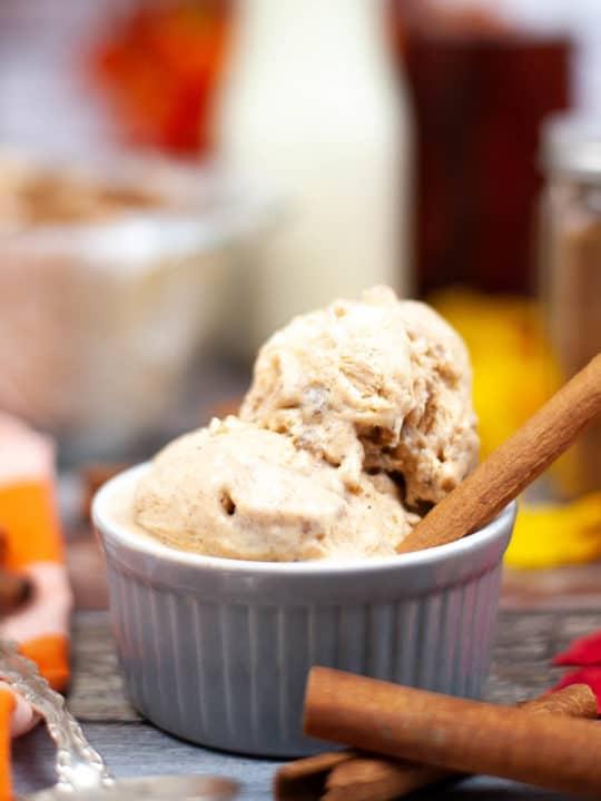 low angle shot of pumpkin ice cream with cinnamon sticks